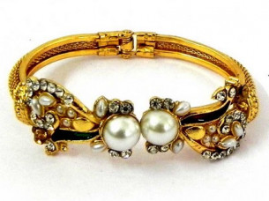 Multi Stone Pearl Studded Gold Plated Bangle..