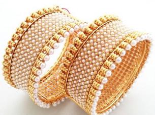 Gold Tone Pearl Work Women Fashion Bangles..
