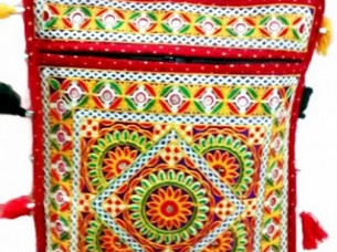 Traditional Look women Embroidery work hand bag cum should..