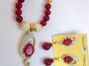 Cubic Zirconia Studded Necklace Set with Pearl Drop..
