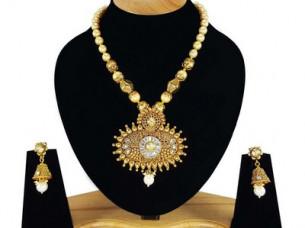 Gold Plated Designer Party wear Polki Pendant Set..